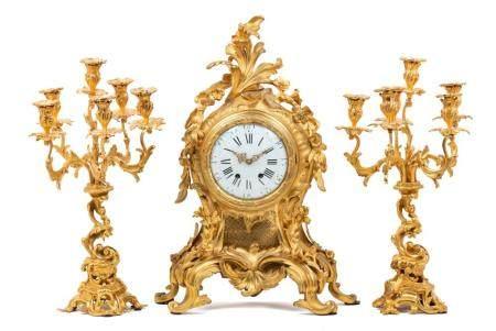 A Louis XV Style Gilt Bronze Three-Piece Clock Garniture