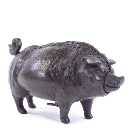 A Victorian bronze butcher's shop counter bell in the form of a pig, with clockwork mechanism in
