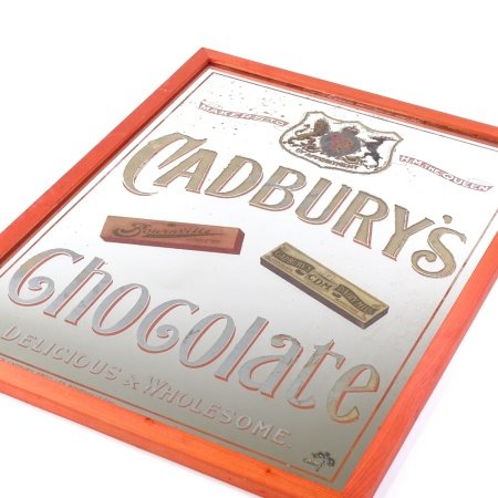 A Victorian Cadbury's Chocolate advertising wall mirror with pictorial designs and Royal Appointment