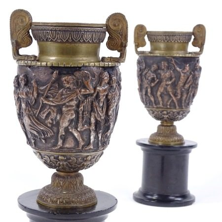 A pair of 19th century relief moulded bronze Classical urns, by John Grinsell & Sons of