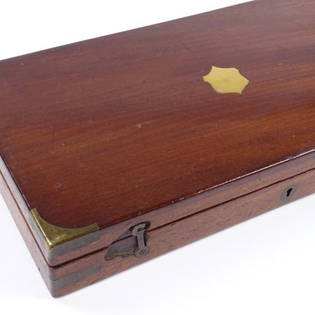 A brass-bound mahogany gun box, with fitted interior for a pair of pistols, label for Robert
