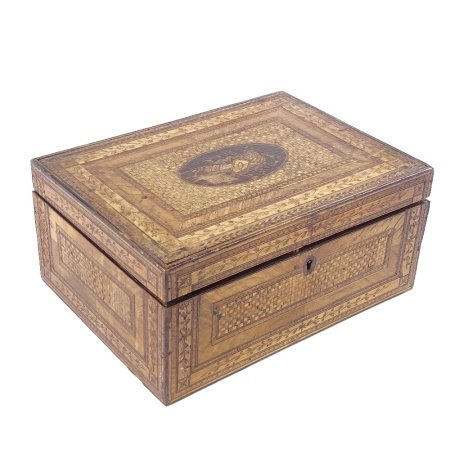 A Napoleonic prisoner of war straw-work box, the lid decorated with Classical emblem and flags,