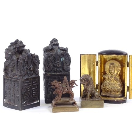 A pair of Chinese relief cast bronze seals, height 10cm, 2 smaller bronze seals, and a miniature