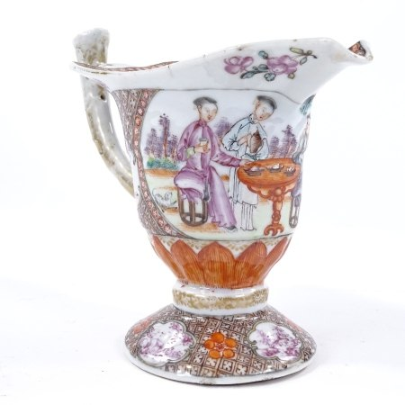 An 18th century Chinese porcelain sauce boat with polychrome hand painted decoration, depicting