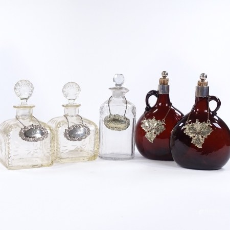 5 various 19th century cut-glass decanters, all with silver or electroplate labels (5)