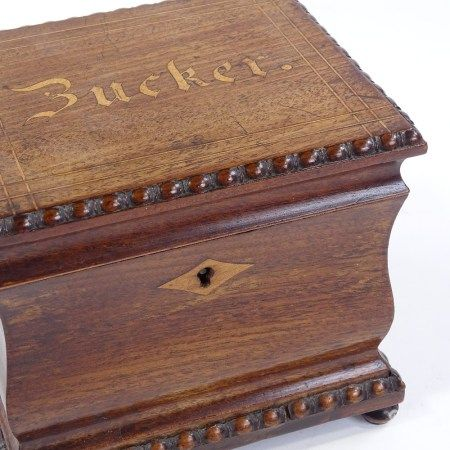 A 19th century Continental mahogany tea caddy, the lid inscribed Bucker, in beaded surround with