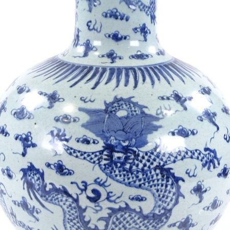 A large Chinese blue and white porcelain narrow-necked vase, with hand painted dragon decoration,