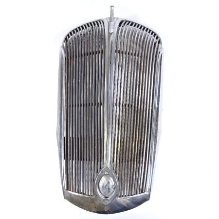 A chrome-plate radiator grill from a motor car, with enamel Union Jack emblem, overall height 78cm