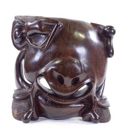 A heavy African relief carved hardwood abstract carving, height 42cm, width 42cm