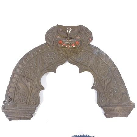 An Oriental relief moulded brass door pediment, width 80cm, height 58cm