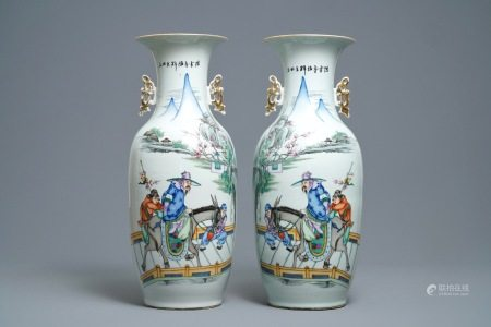A pair of Chinese famille rose vases with travellers on a donkey, 19/20th C.