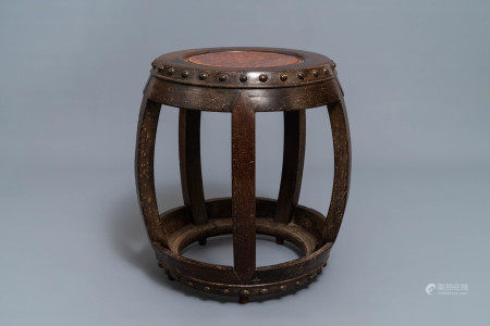 A Chinese carved hardwood stand with rootwood top, 19th C.