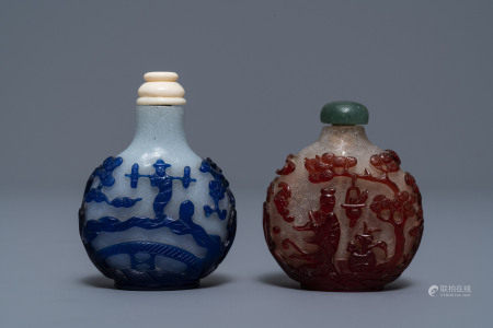 Two Chinese overlay red and blue snowflake glass snuff bottles, 19th C.