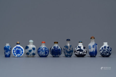 Nine various Chinese blue overlay and transparent glass snuff bottles, 19/20th C.