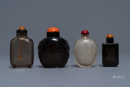 Four Chinese smokey quartz and simulating glass snuff bottles, 18/19th C.