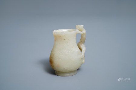 A Chinese celadon russet jade chilong- Handled jug, Qing