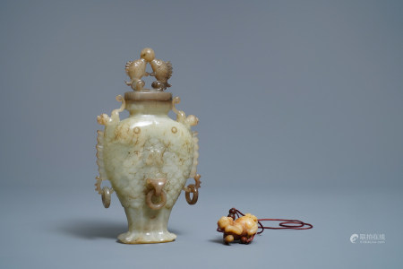 A Chinese jade 'twin fish' vase and a russet jade model of a dog, 19/20th C.