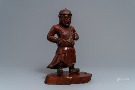 A tall Chinese lacquered wood figure of a guardian, 19th C.