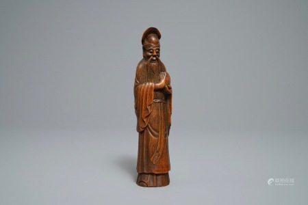 A Chinese carved bamboo figure of Shoulao, Qianlong/Jiaqing