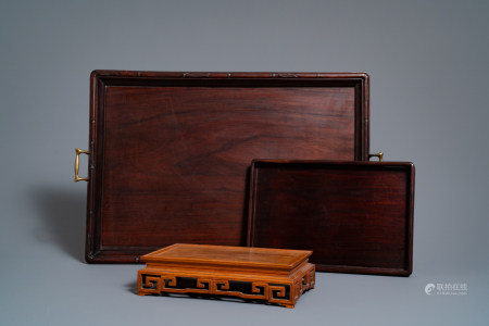 Two Chinese carved wooden trays and a stand, 18/19th C.