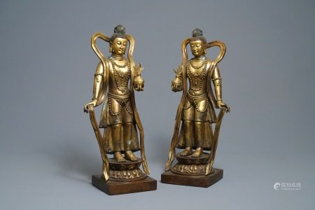 A pair of large Chinese gilt bronze figures, 19th C.