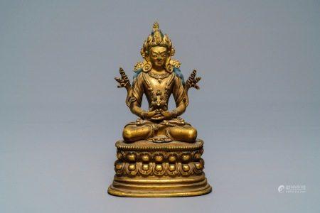 A Chinese gilt bronze figure of Amitayus, 17/18th C.