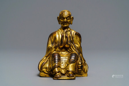 A Sino-Tibetan gilt bronze figure of a Lama, 19th C.