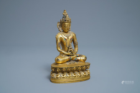 A Chinese coral- and turquoise-inlaid gilt bronze figure of Buddha Amitayus, 18/19th C.