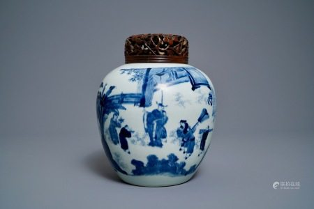 A Chinese blue and white ginger jar with figures in a landscape and a wooden cover, Transitional period