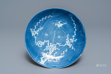 A rare Chinese reverse-decorated 'magpie and prunus' plate, Transitional period