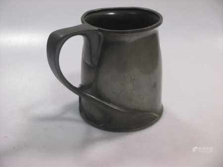A Tudric pewter pint mug, Liberty. Probably to a design by Archibald Knox.