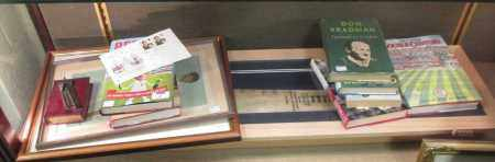 A 2009 Ashes cricket bat, signed together with various books and 2 Spy cricketing prints