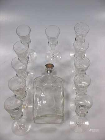A glass cordial decanter and 11 glasses engraved with coronet above G