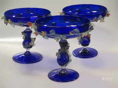 A set of four Murano blue glass comports,