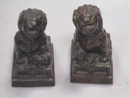 A pair of Chinese bronze lions, 12cm high