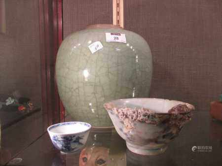 A Celadon oval jar, lacking lid, 22cm high together with two Nankin cargo type Chinese bowls (3)