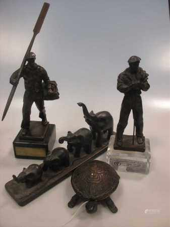 A 20th century bronze figure of an oarsman, another similar and other items