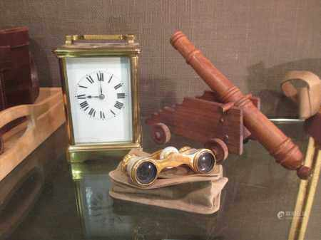 A French carriage timepiece, opera glasses and model canon.