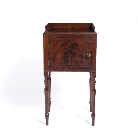 Mahogany pot cupboard 19th Century, with shaped tray top and cut carrying handles on turned supports