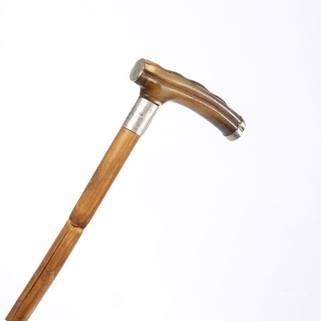 Bamboo walking stick with a silver mount and a rhinoceros horn handle, circa 1900 88cm high