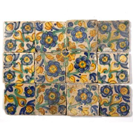 Twelve 17th/18th Century probably Spanish tiles tin glazed polychrome painted, decorated with floral
