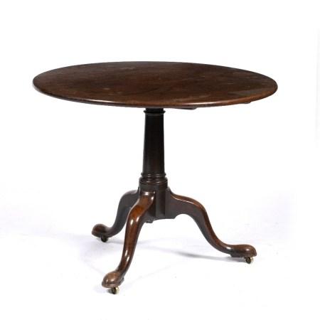 Large mahogany tilt top tripod table 19th Century, on a raised turned column and tripod base 91cm