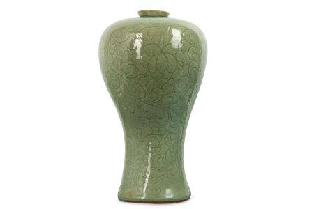 A KOREAN CELADON-GLAZED 'BLOSSOMS' VASE. With a tapered body and a bulging shoulder carved with