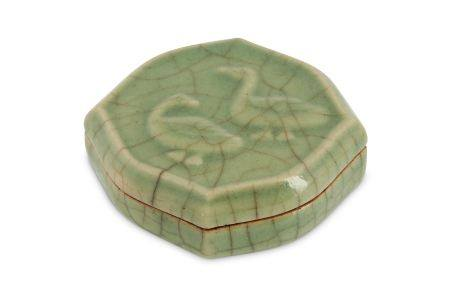 A CHINESE CELADON-GLAZED 'DUCK' COSMETIC BOX AND COVER.
