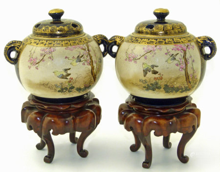 Pair of Japanese satsuma vases on stands, (chip to the inner lip of one vase, gilt wear) We are