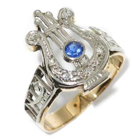 Anillo en oro bicolor de 18k con diamantes y zafiro