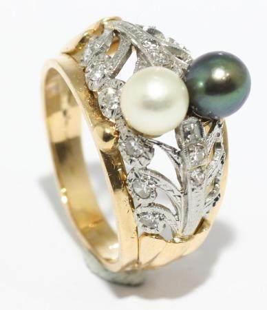 Sortija de oro amarillo y blanco 18k con dos perlas