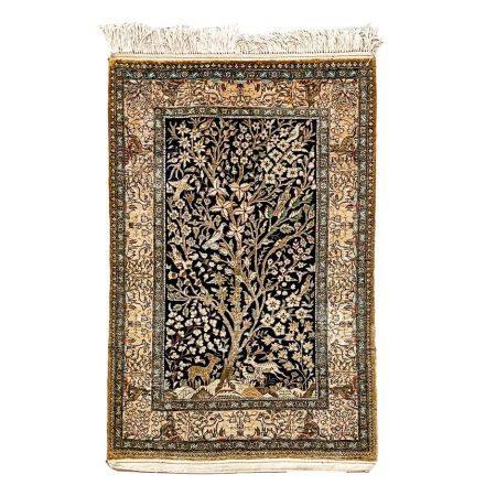 A SILK QUM RUG, IRAN, MODERN 145 by 83cm