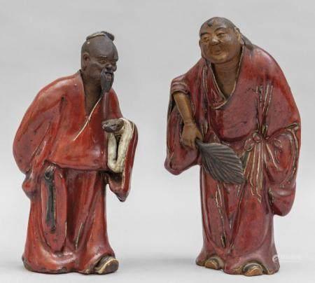 Coppia di sculture in gres dipinto raffiguranti