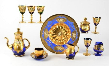 A Bohemian glass service with gilt overlay, including two large bowls, a teapot and cups, multiple